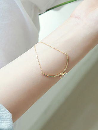 Adjustable arc faux-diamond bracelet