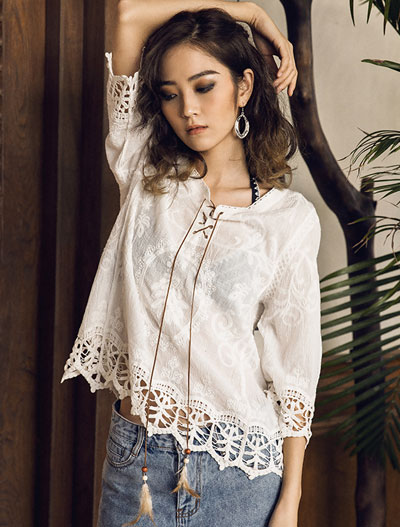 Embroidered feather embellished cotton top
