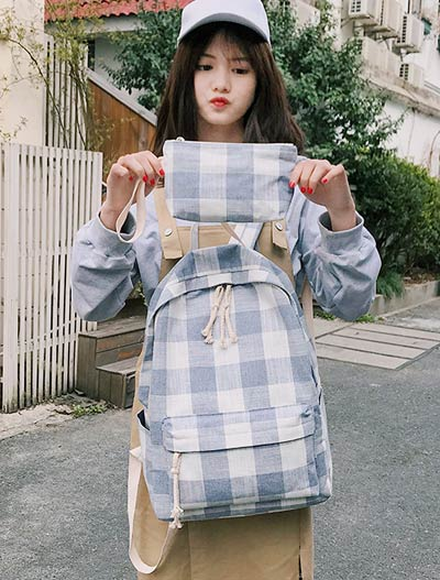 Checked canvas backpack + clutch bag