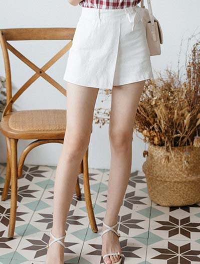 Asymmetric belted wide-leg cotton shorts